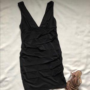 Very sexy little black dress- fits like a medium.